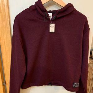 Pink cropped hooded sweatshirt